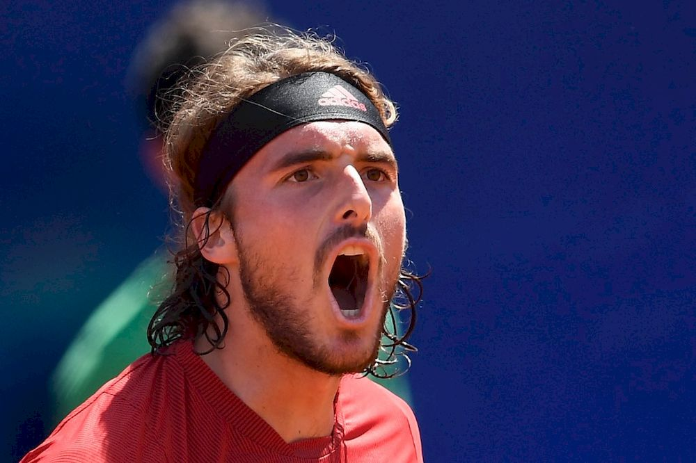 Greece's Stefanos Tsitsipas celebrates after winning his ATP Barcelona Open tennis tournament singles semi-final match against Italy's Jannik Sinner at the Real Club de Tenis in Barcelona on April 24, 2021. — AFP pic