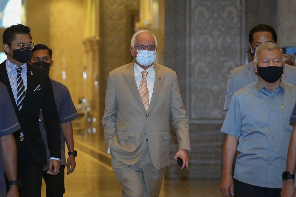 Datuk Seri Najib Razak arrives at the Court of Appeal in Putrajaya April 13, 2021. — Picture by Yusof Mat Isa