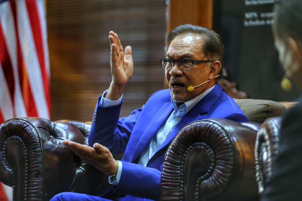 Datuk Seri Anwar Ibrahim said Malaysia's Covid death rate, which had climbed up rapidly from single digits to triple digits since March, might be avoided if the government has succeeded in rolling out the vaccine as initially planned. ― Picture by Ahmad Zamzahuri