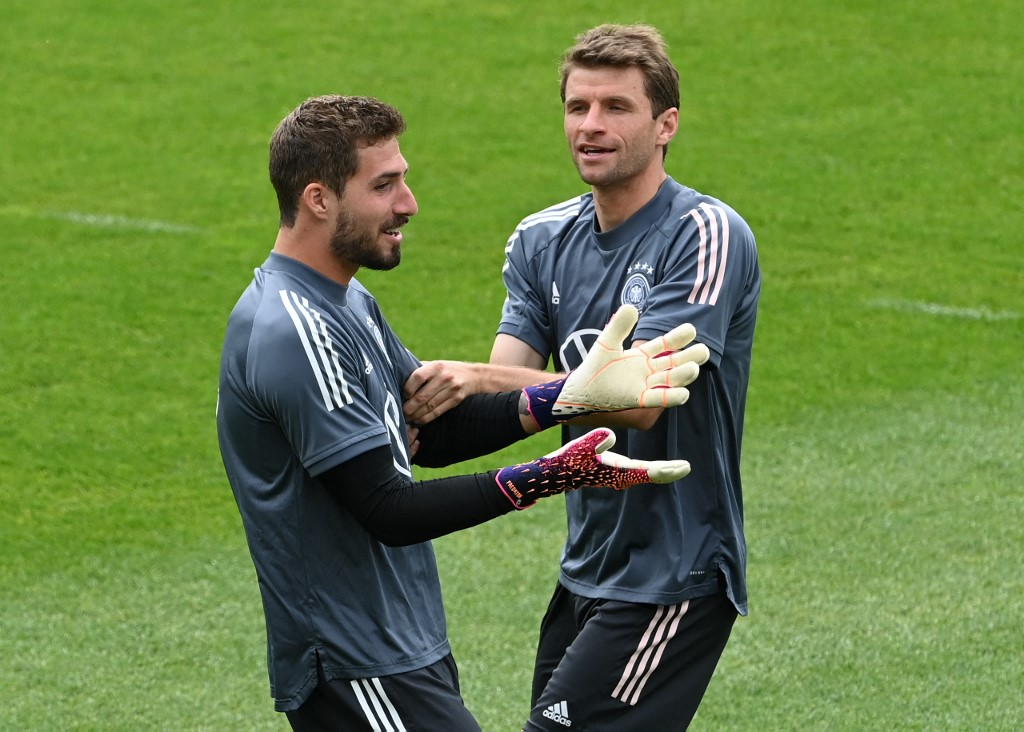 Germany's forward Thomas Mueller (right) jokes with goalkeeper Kevin Trapp during a training session on June 5, 2021, in Seefeld, Austria, where the German national football team attends a training camp ahead of the European championship 2020-2021. —