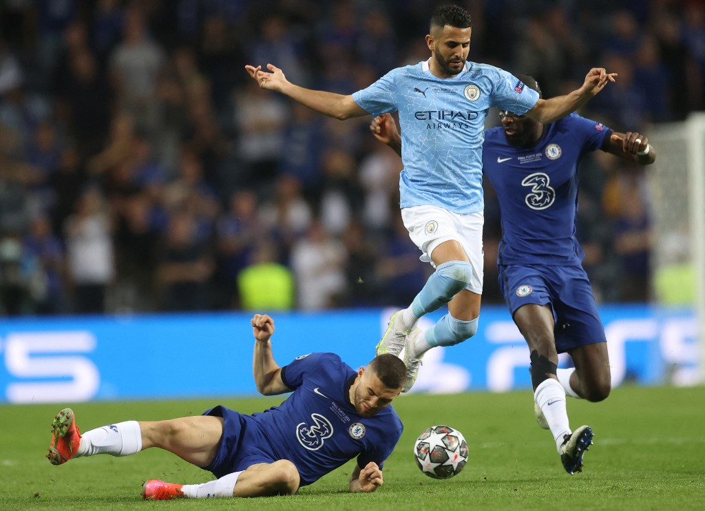Manchester City's Algerian midfielder Riyad Mahrez (C) jumps over Chelsea's Mateo Kovacic (L) as defender Antonio Ruediger (R) chases them during the UEFA Champions League final. (AFP)