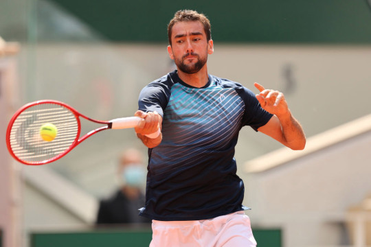 Marin Cilic of Croatia plays a forehand during his mens second round match against Roger Federer of Switzerland during day five of the 2021 French Open at Roland Garros on June 03, 2021 in Paris, France.