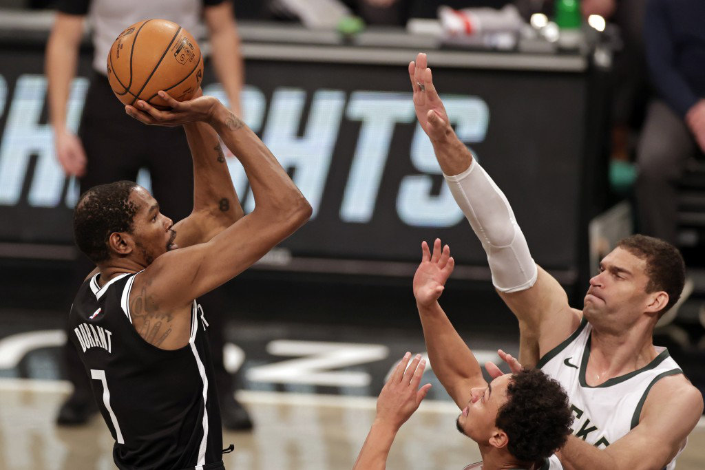 Brooklyn Nets forward Kevin Durant shoots over Milwaukee Bucks center Brook Lopez during their NBA basketball game on Jan. 18, 2021, in New York. (AP file photo)