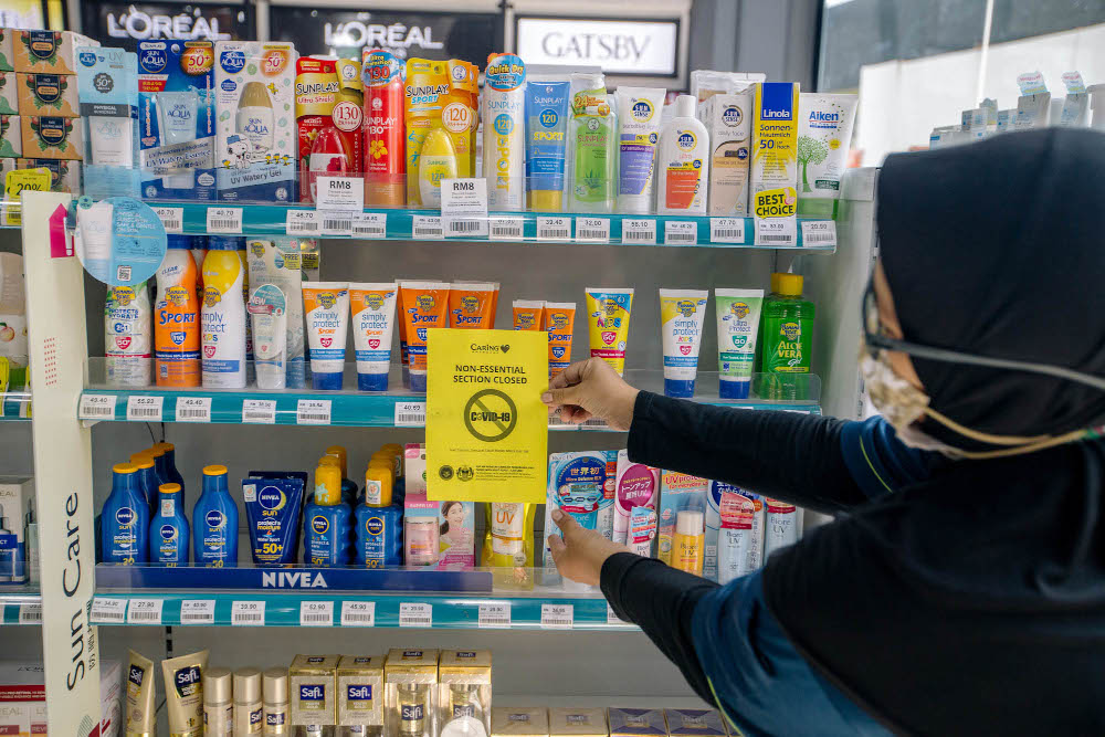 A section of a Caring pharmacy is seen in Kuala Lumpur June 4, 2021. The non-essential sections which selling hair colours, suncare, facial masks and men's hair gel are closed due to the Full Movement Control Order (FMCO). — Picture by Firdaus Latif