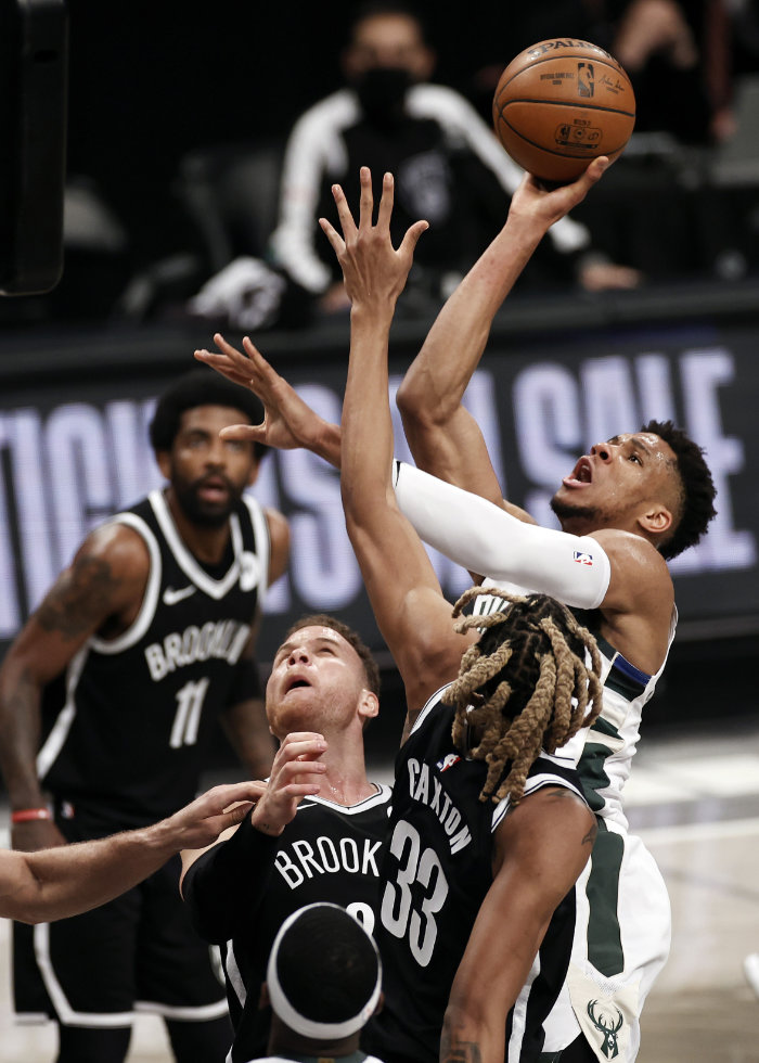 Milwaukee Bucks forward Giannis Antetokounmpo shoots over Brooklyn Nets forward Nicolas Claxton during Game 1 of their NBA basketball second-round playoff series on June 5, 2021, in New York. (AP Photo/Adam Hunger)