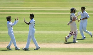 India's Pooja Vastrakar celebrates with teammate after taking the wicket of England's Lauren Winfield-Hill.