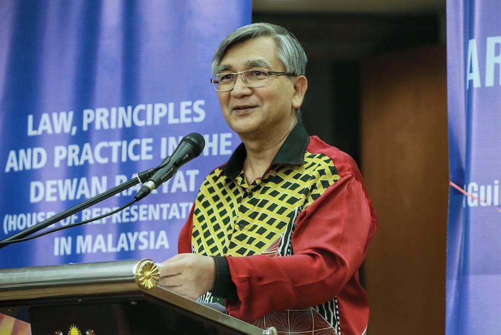 File picture the then-Dewan Rakyat Speaker Tan Sri Datuk Mohamad Ariff Md Yusof (centre) launching his book at Parliament, March 2, 2020. —Picture by Ahmad Zamzahuri