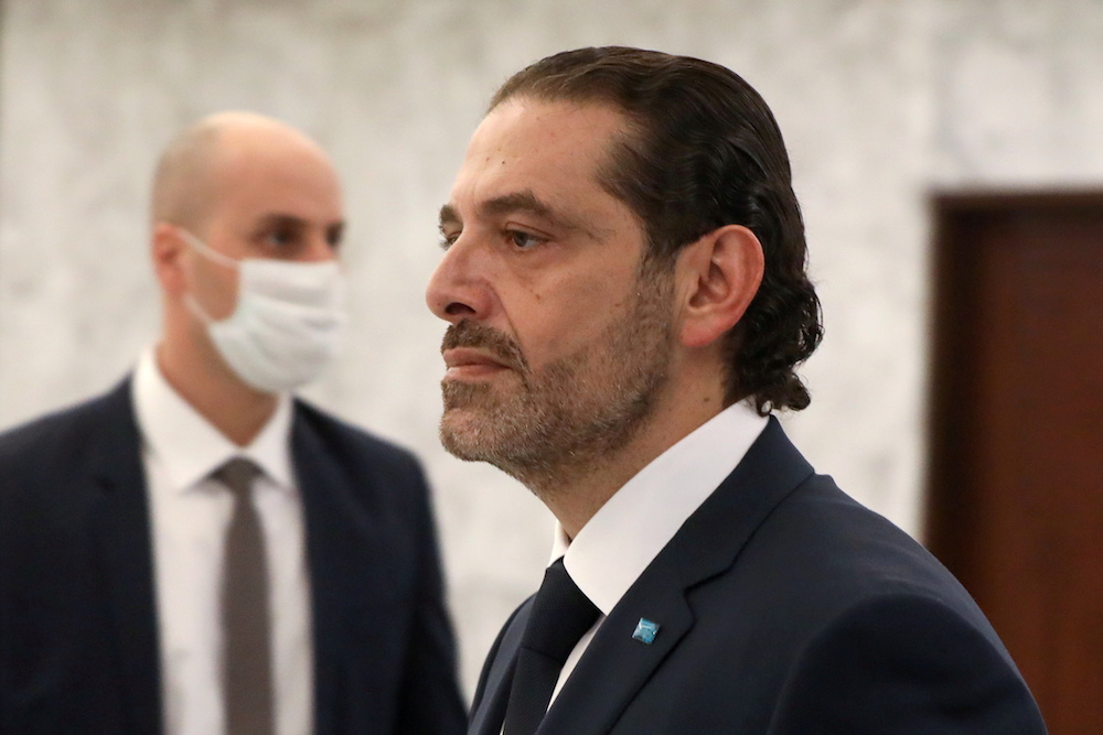 Prime Minister-designate Saad Al-Hariri walks by after meeting with Lebanon's President Michel Aoun at the presidential palace in Baabda, Lebanon March 22, 2021. (Reuters)