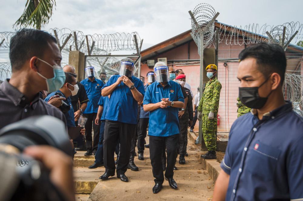 Home Minister Datuk Seri Hamzah Zainudin visits the temporary Beranang Satellite Prison and Immigration Depot in Beranang, June 3, 2021. — Picture by Shafwan Zaidon
