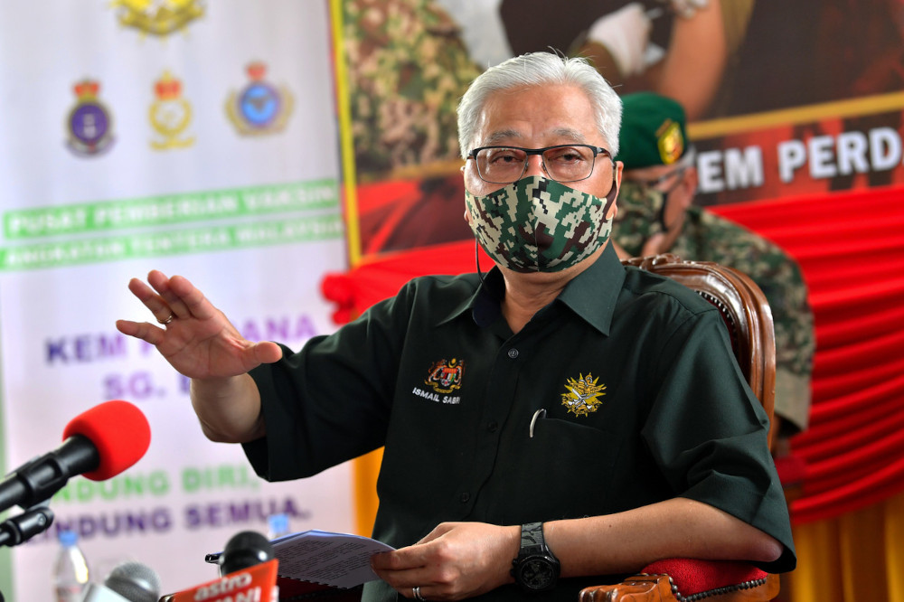 Senior Minister of Defence Datuk Seri Ismail Sabri Yaakob speaks to the media after visiting the drive-through vaccination centre at the Sungai Besi military camp, June 8, 2021. — Bernama pic