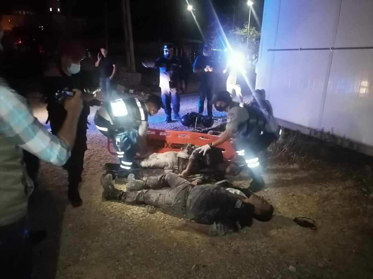 Jordanian security personnel injured in an armed attack in the Malha area of Amman are treated by an ambulance team on Saturday. (Petra News Agency photo via Twitter)