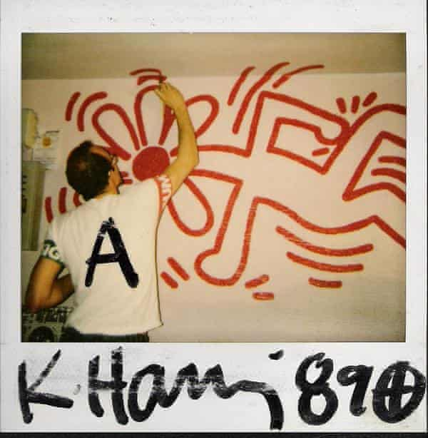 A polaroid of Haring painting the mural in the Ars Studio club, Barcelona, in 1989.