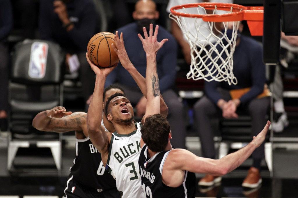 Milwaukee Bucks forward Giannis Antetokounmpo drives to the basket against Brooklyn Nets forward Joe Harris during their NBA game on Jan. 18, 2021, in New York. (AP file photo)