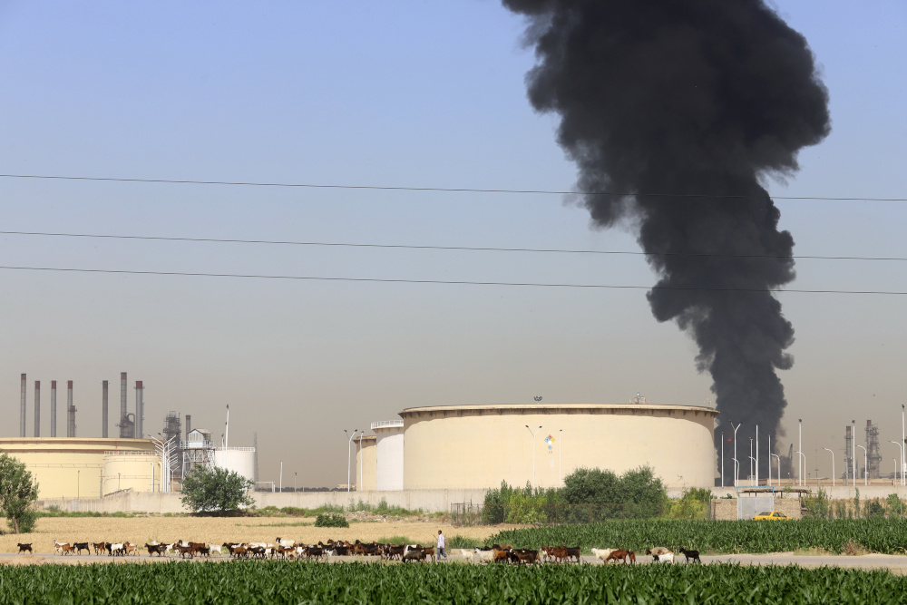 Smoke rises at an oil refinery in Tehran June 3, 2021. — Majid Asgaripour/Wana (West Asia News Agency) pic via Reuters