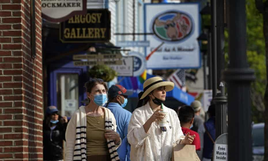 Visitors walk on a busy sidewalk in Bar Harbor, Maine, last month as Governor Janet Mills eliminated most outdoor distancing requirements imposed during the pandemic.