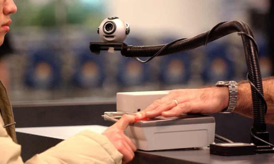 A traveller's fingerprints being checked