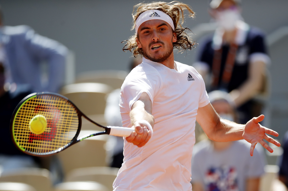 Greece's Stefanos Tsitsipas in action during his fourth round match against Spain's Pablo Carreno Busta at the French Open at Roland Garros, Paris, France June 6, 2021. — Reuters pic