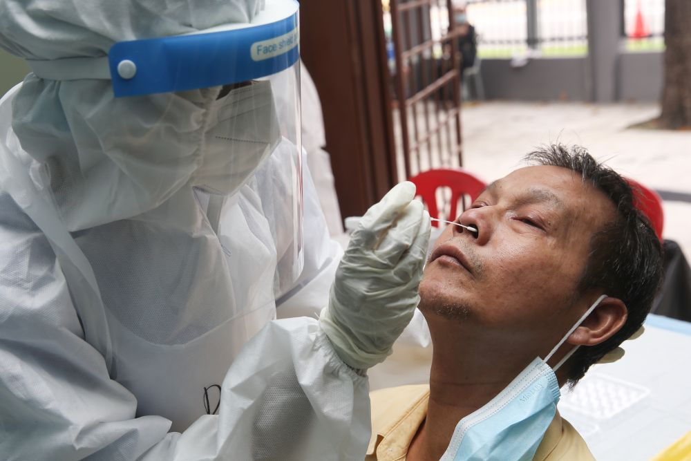 A health worker collects swab samples to test for Covid-19 at the MBPJ community hall in Taman Medan, Petaling Jaya May 24, 2021. — Picture by Choo Choy May