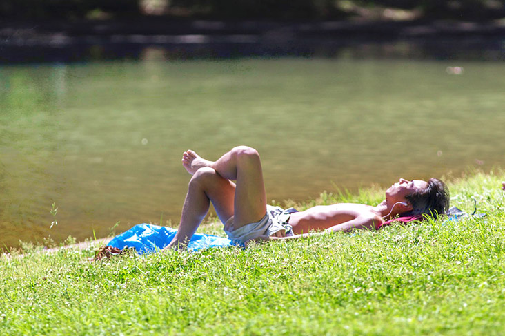 Summertime in Japan means sunbathing in the parks for some. — Pictures by CK Lim