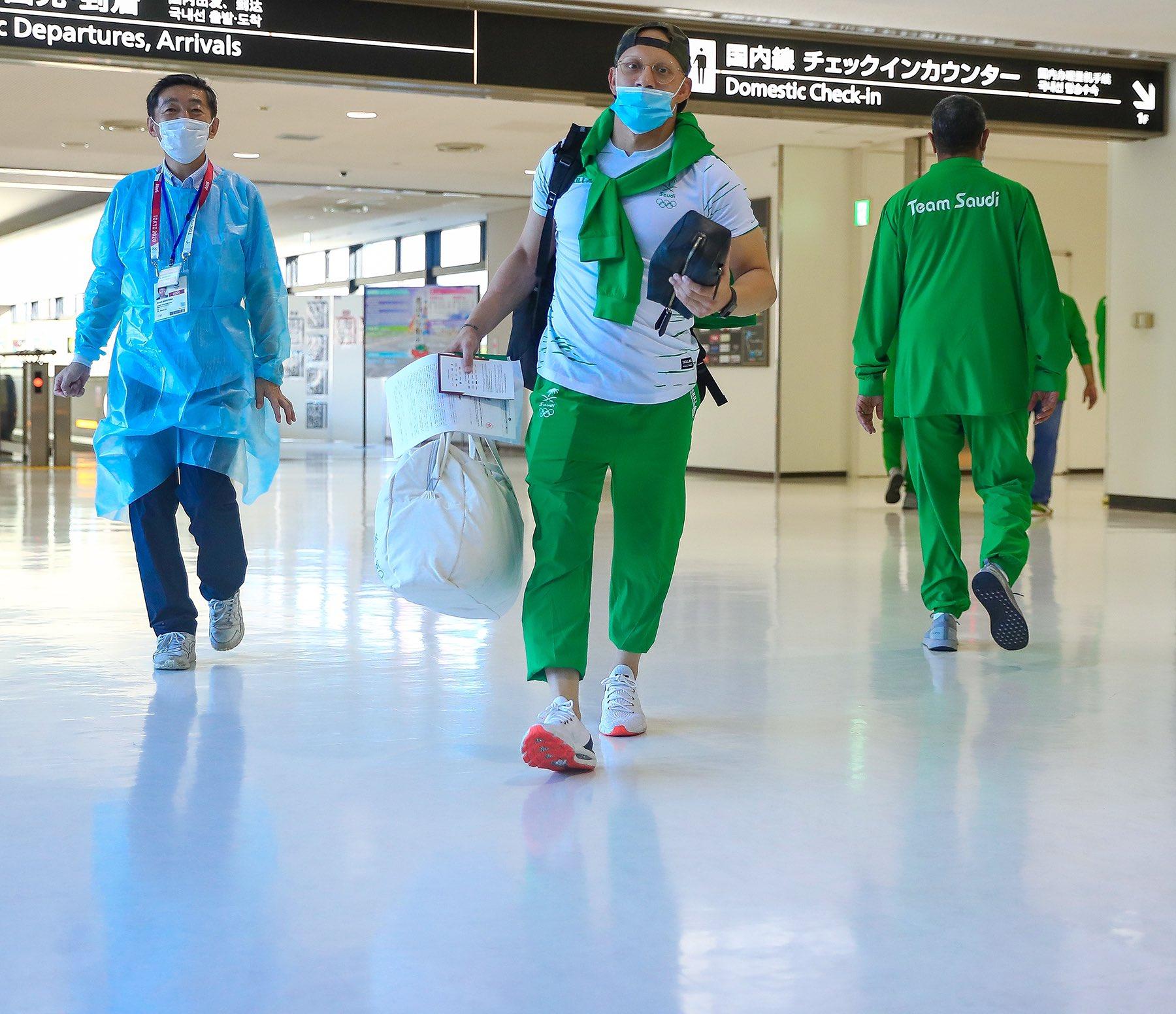 Saudi weightlifters Siraj Al-Saleem and Mahmoud Al-Humayd arrive in Tokyo for the Olympic games. (Twitter/@saudiolympic)