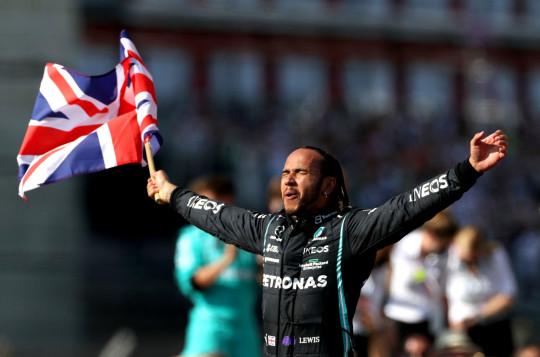 Lewis Hamilton celebrates winning the British Grand Prix at Silverstone