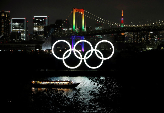 The Rainbow Bridge and Tokyo Tower are illuminated with Olympic colours