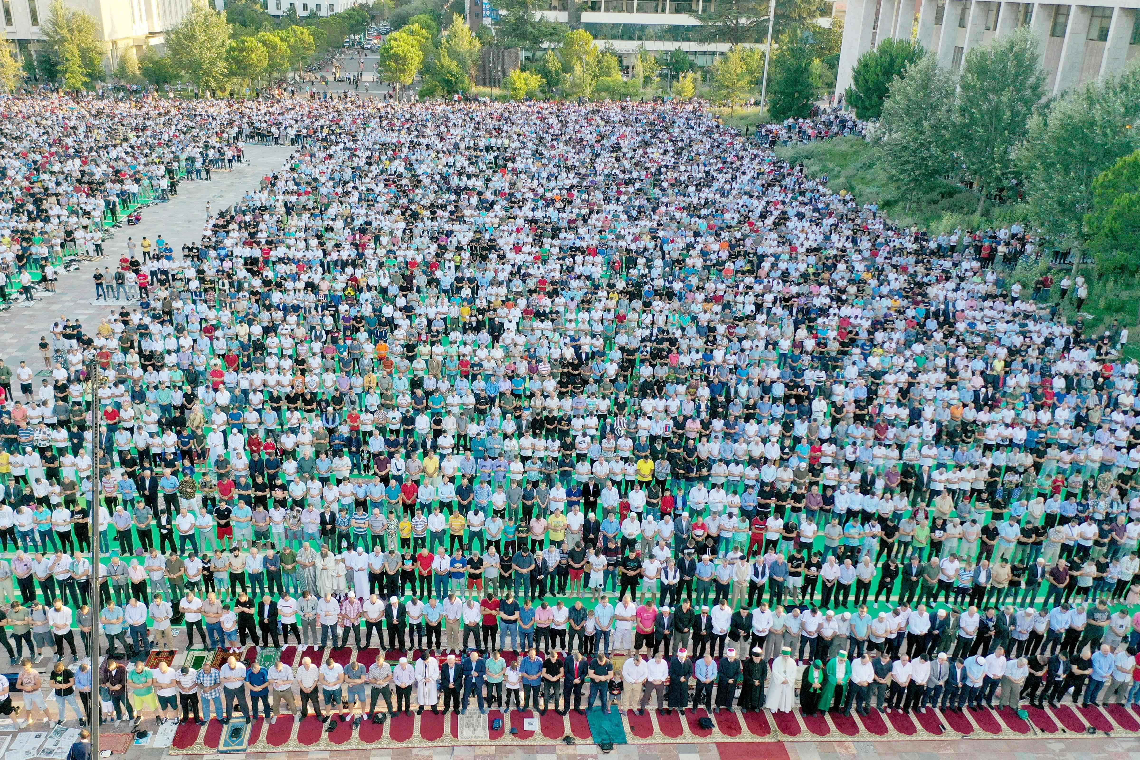 This aerial view shows Albanian Muslims attending the Eid Al-Adha prayer at Skenderbej Square in Tirana on July 20, 2021. (AFP)