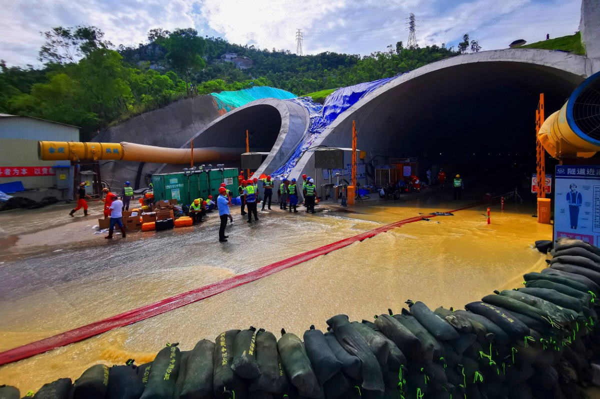 Rescuers build embankments to pump out water from a flooded tunnel in Zhuhai city in south China's Guangdong province on July 16, 2021. (Chinatopix via AP)