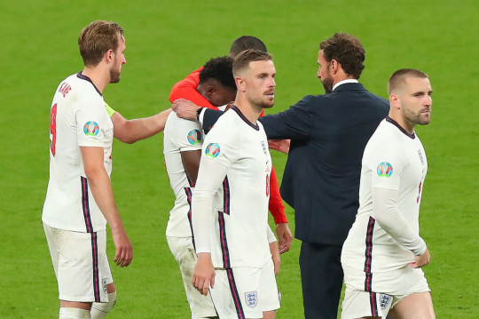 Bukayo Saka consoled by England team-mates and Gareth Southgate after his penalty miss in the Euro 2020 final against Italy