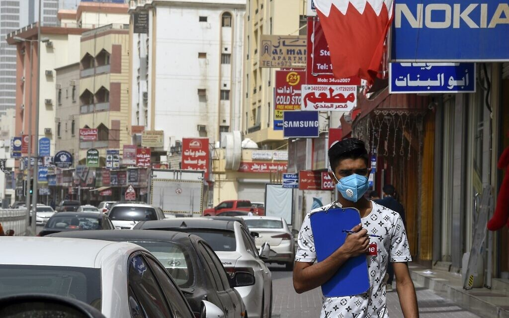A man wearing a surgical mask is pictured in the heart of the Bahraini capital Manama. (File/AFP)