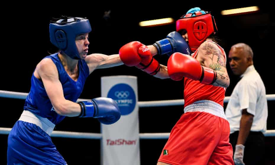 Charley Davison (left) lands a left on Carly McNaul during their bout at an Olympic qualifying event in March 2020.