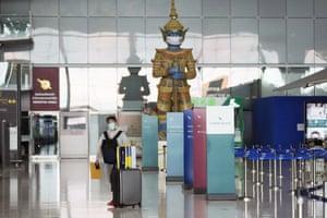 A lone passenger at Suvarnabhumi airport in Bangkok, Thailand,.