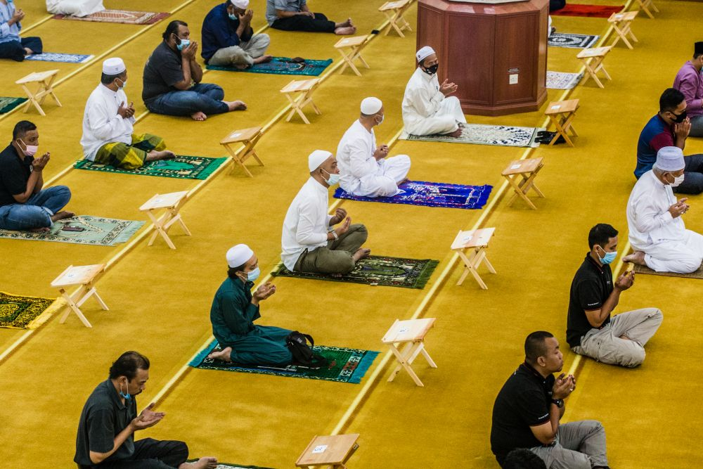 Malaysian Muslims observe social distancing while performing Friday prayers at the Al-Hidayah Mosque during recovery movement control order in Kampung Sungai Penchala, Segambut June 12, 2020. — Picture by Firdaus Latif