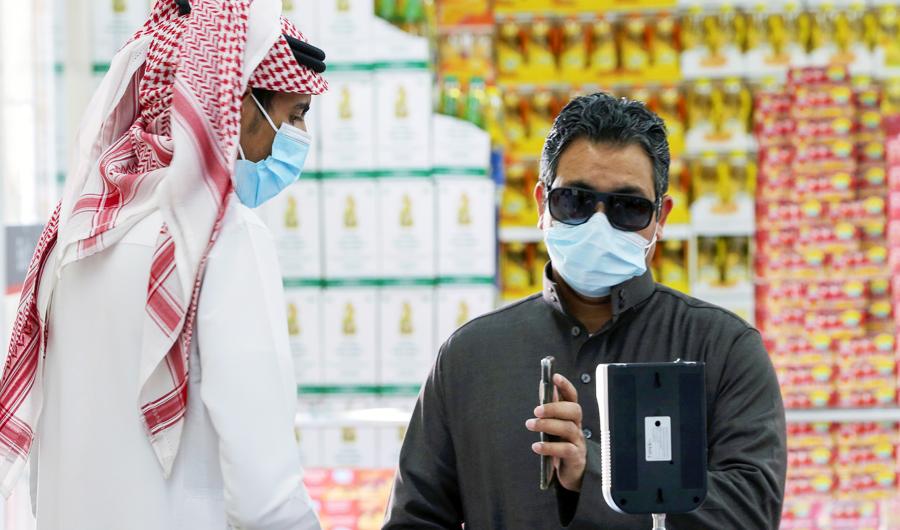 A man displays his details on his mobile phone using the Tawakkalna app as he enters the Al-Othaim market in Riyadh, Saudi Arabia. (REUTERS file photo)