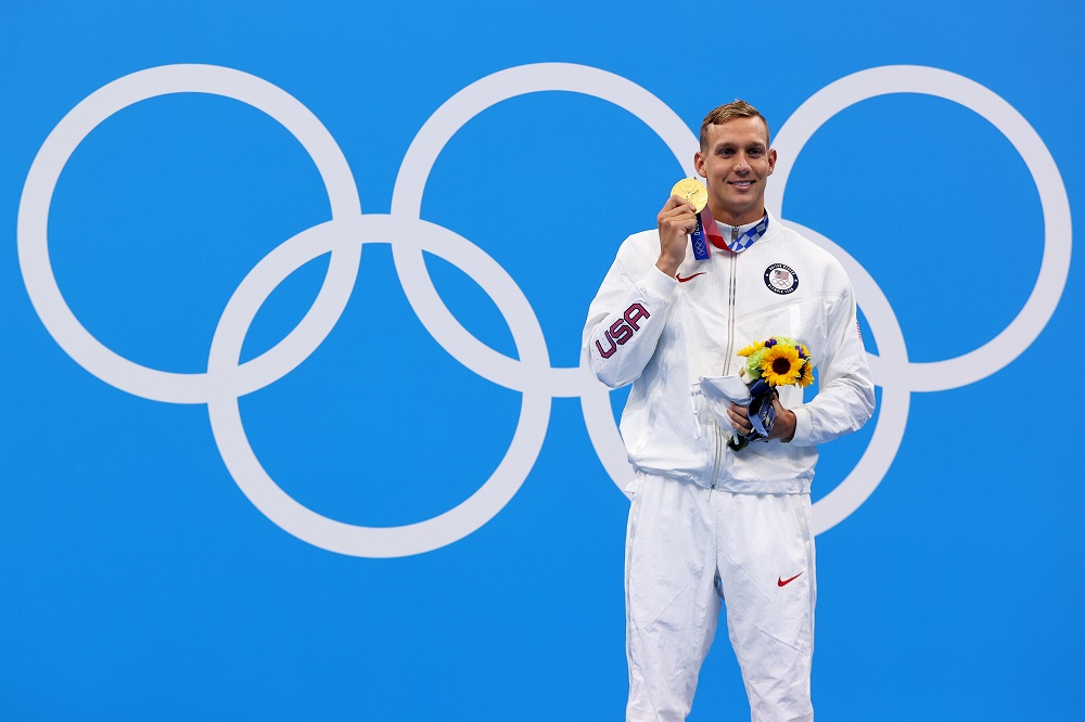 Caeleb Dressel of the United States poses with his gold medal after winning the Men's 100m Butterfly July 31, 2021. ― Reuters pic