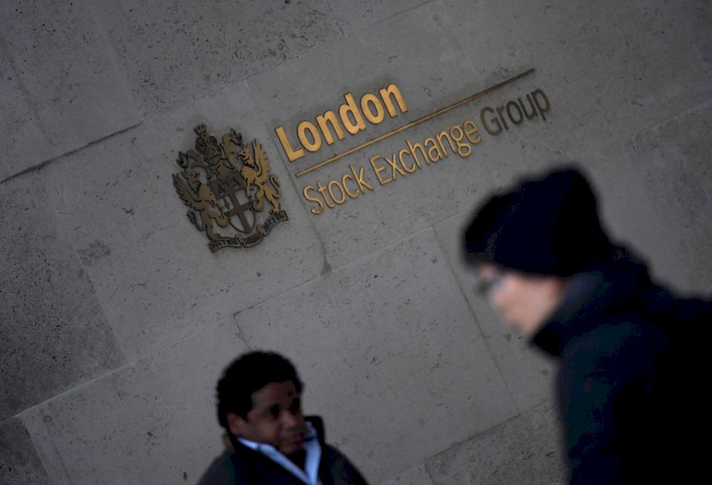 People walk past the London Stock Exchange Group offices in the City of London, Britain, December 29, 2017. — Reuters pic