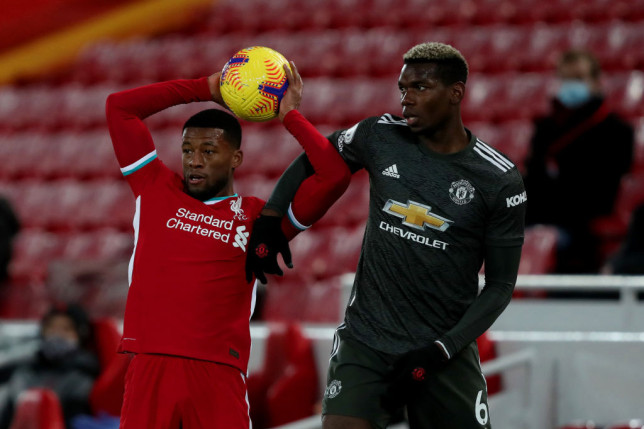Gini Wijnaldum and Paul Pobga do battle in Liverpool's clash with Manchester United