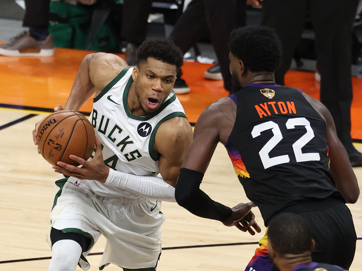 Buck's forward Giannis Antetokounmpo drives to the basket against against Deandre Ayton of the Suns during  Game Five of the NBA Finals in Phoenix, Arizona. (AFP / GETTY IMAGES NORTH AMERICA)