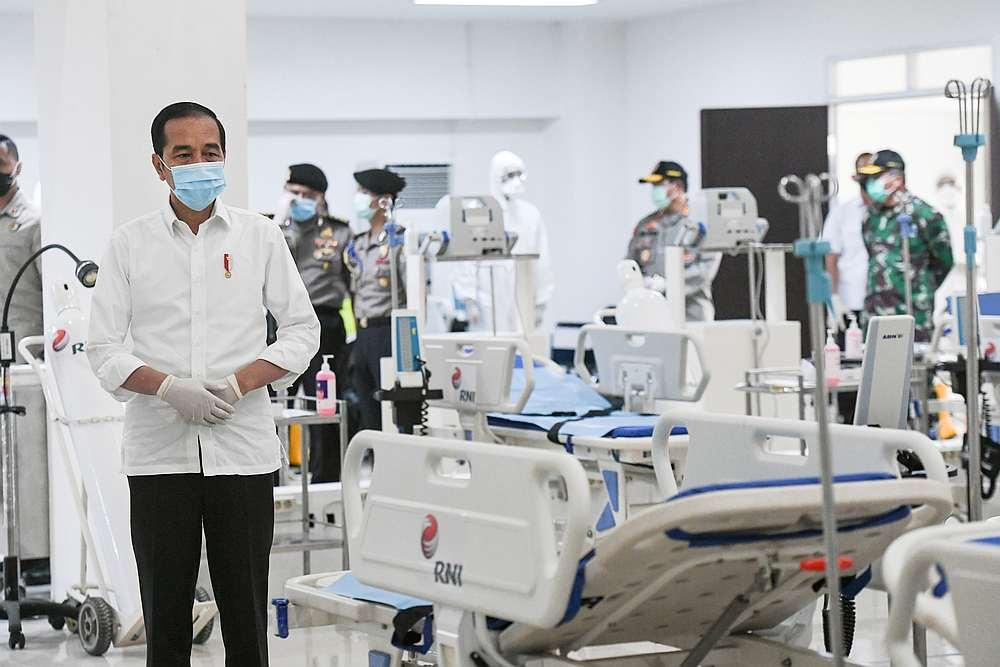Indonesia's President Joko Widodo takes a look at the emergency hospital handling of Covid-19 in Kemayoran Athletes Village, in Jakarta March 23, 2020. — Antara Foto/Hafidz Mubarak A pic via Reuters