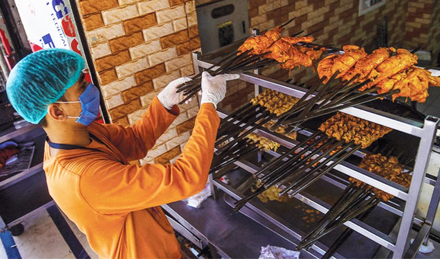 A worker arranges barbecue meat at a restaurant in Karachi, Pakistan. (AFP)