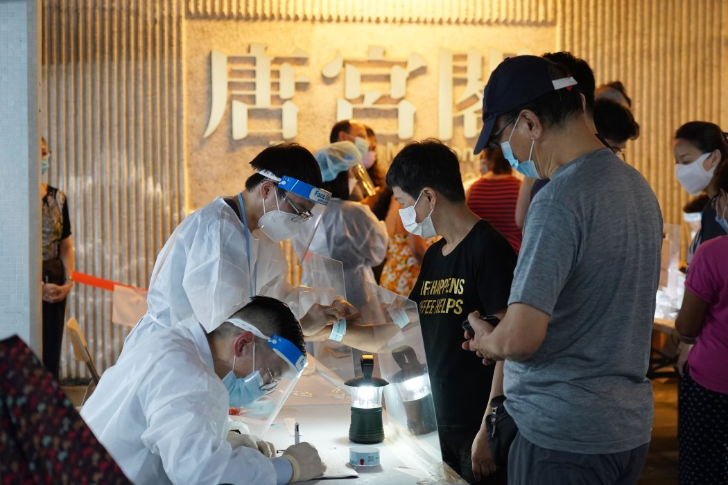 Residents in Taikoo Shing's Tang Kung Mansion received mandatory Covid-19 tests during an area lockdown.