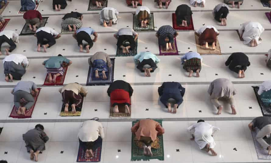 Muslims pray spaced apart as a precaution against the coronavirus outbreak during an Eid al-Adha prayer at Zona Madina mosque in Bogor, Indonesia