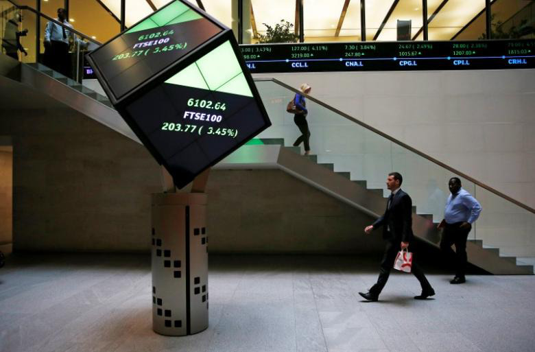People walk through the lobby of the London Stock Exchange in London August 25, 2015. — Reuters pic