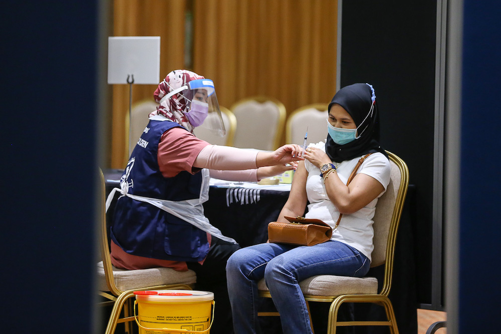 Manufacturing workers in Selangor receive their Pikas Covid-19 jab at the vaccination centre at Setia City Convention Centre in Shah Alam June 28, 2021. — Picture by Yusof Mat Isa