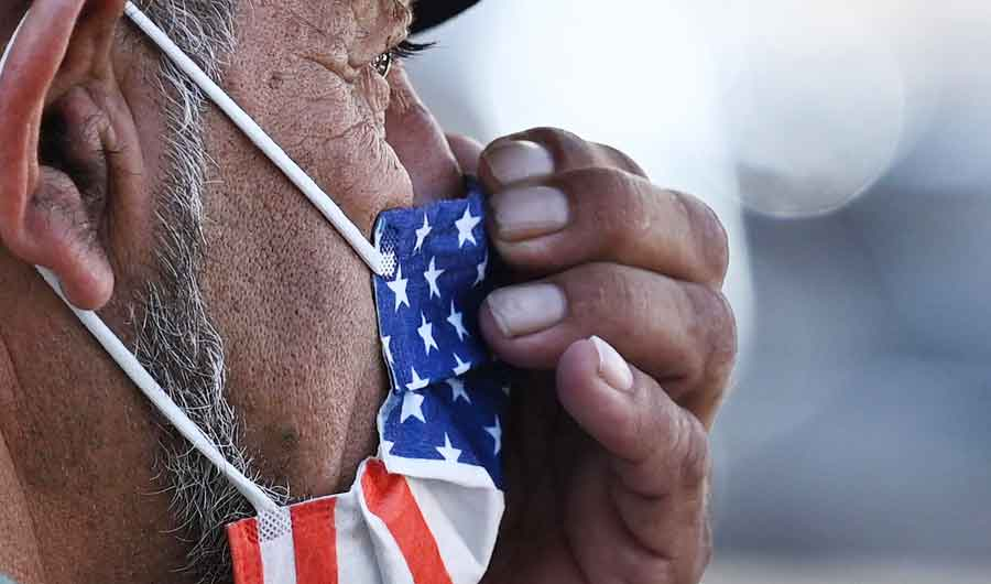 A man adjusts his American flag face mask on July 19, 2021 on a street in Hollywood, California. (AFP file photo)