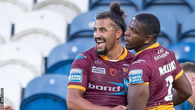 Jermaine McGillvary's (right) four-try haul helped Huddersfield to their first Super League win since beating bottom side Leigh 44-6 on 23 May