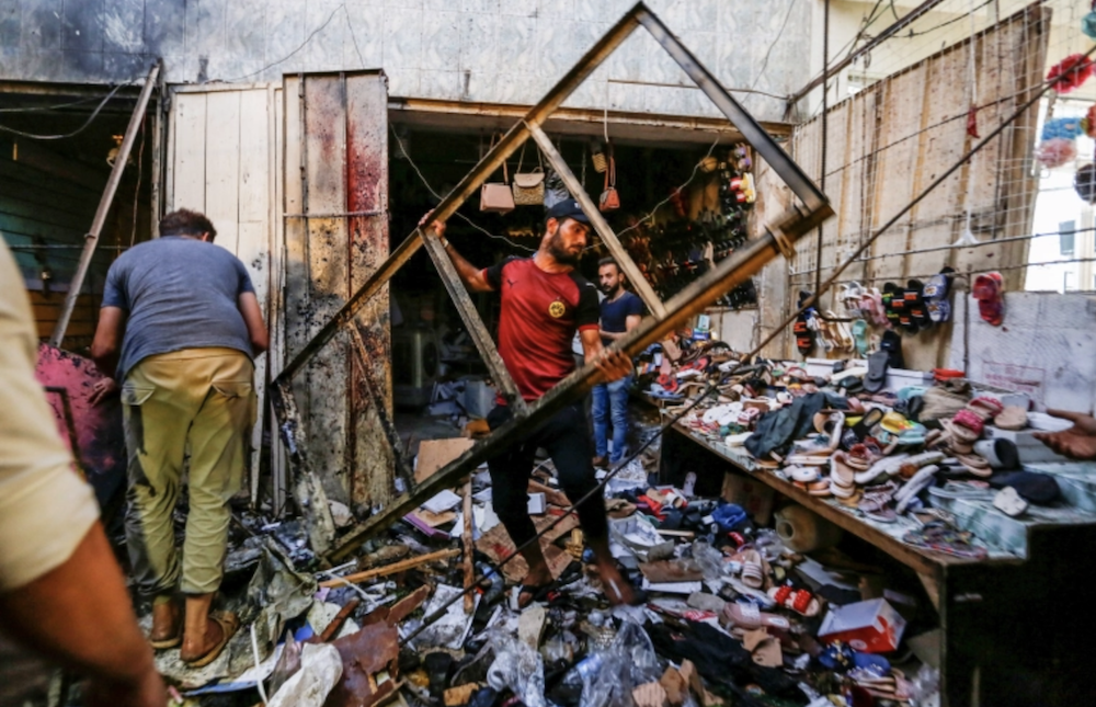 The blast, the deadliest in the Iraqi capital over the past six months, took place in Al-Wuhailat market as families prepared for Eid Al-Adha. (Reuters)