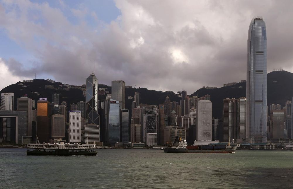 A Star Ferry sails past Hong Kong's business Central district June 18, 2014. — Reuters pic