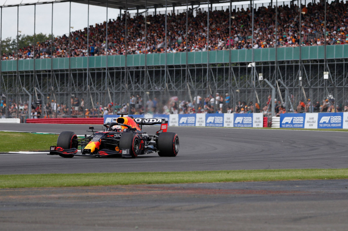 Max Verstappen drives at Luffield Corner during the practice 1 session of the Formula One British Grand Prix on July 16, 2021. (AFP)