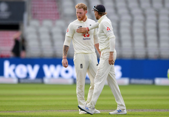 England's Joe Root (R) congratulates England's Ben Stokes (L) at the end of play on the third day of the first Test cricket match between England and Pakistan at Old Trafford in Manchester, north-west England on August 7, 2020. (Photo by Dan Mullan / POOL / AFP) / RESTRICTED TO EDITORIAL USE. NO ASSOCIATION WITH DIRECT COMPETITOR OF SPONSOR, PARTNER, OR SUPPLIER OF THE ECB (Photo by DAN MULLAN/POOL/AFP via Getty Images)